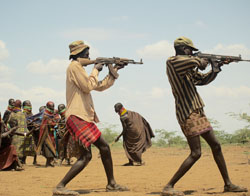 Young Turkana men will gather from all around to participate in large raids.