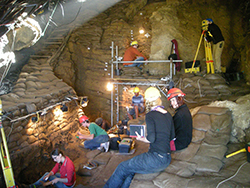 Inside caves at the southern most tip of South Africa, scientists and students work to excavate artifacts from over 50,000 years of human activity. Image by Curtis Marean.